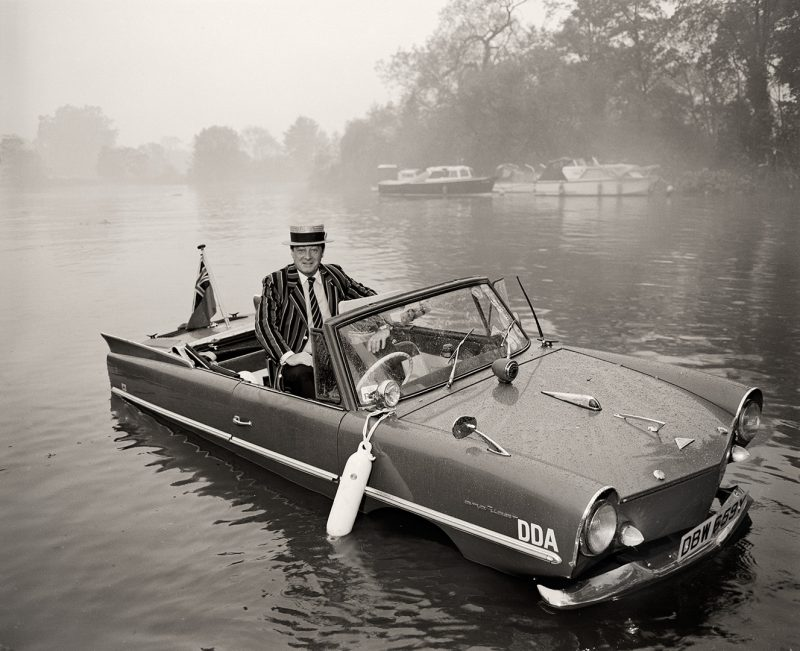 Amphicar 770 in the Thames in Twickenham, adjacent to Eel Pie Island. Classic and Sportscar, 1985-86